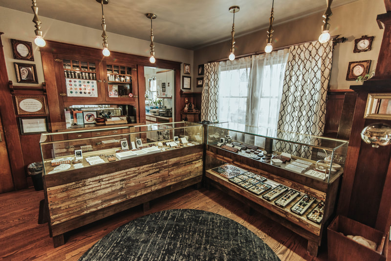 Front desk and jewelry displays at Black Hole Body Piercing