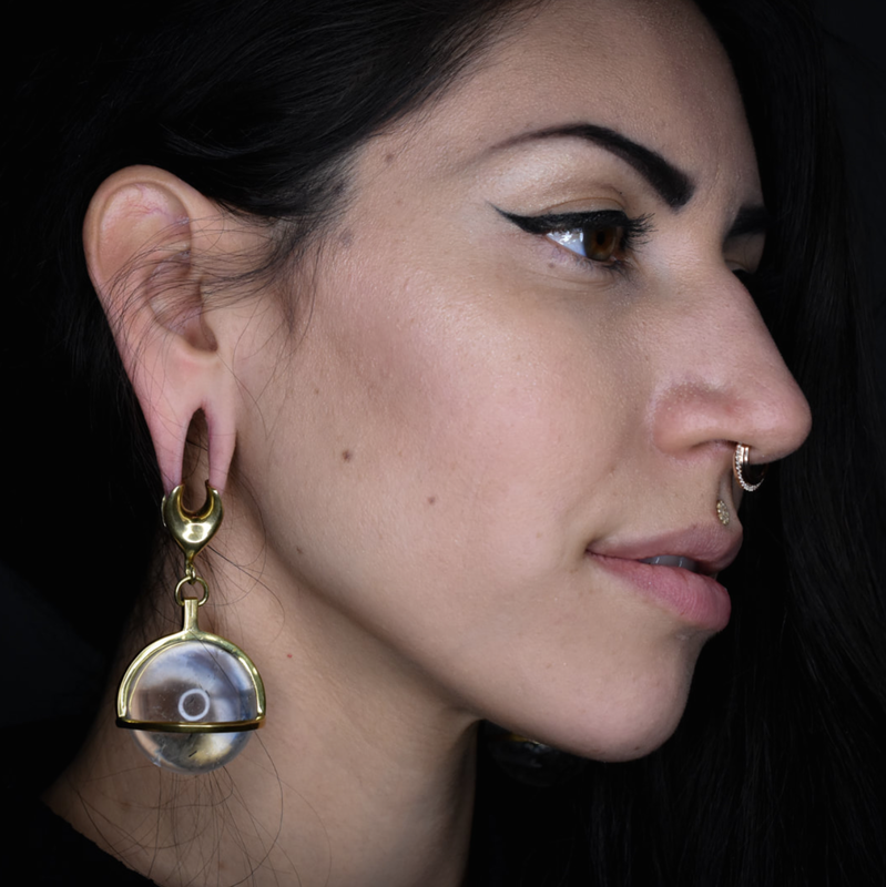 Black Hole Body Piercing client displays ear and septum piercings