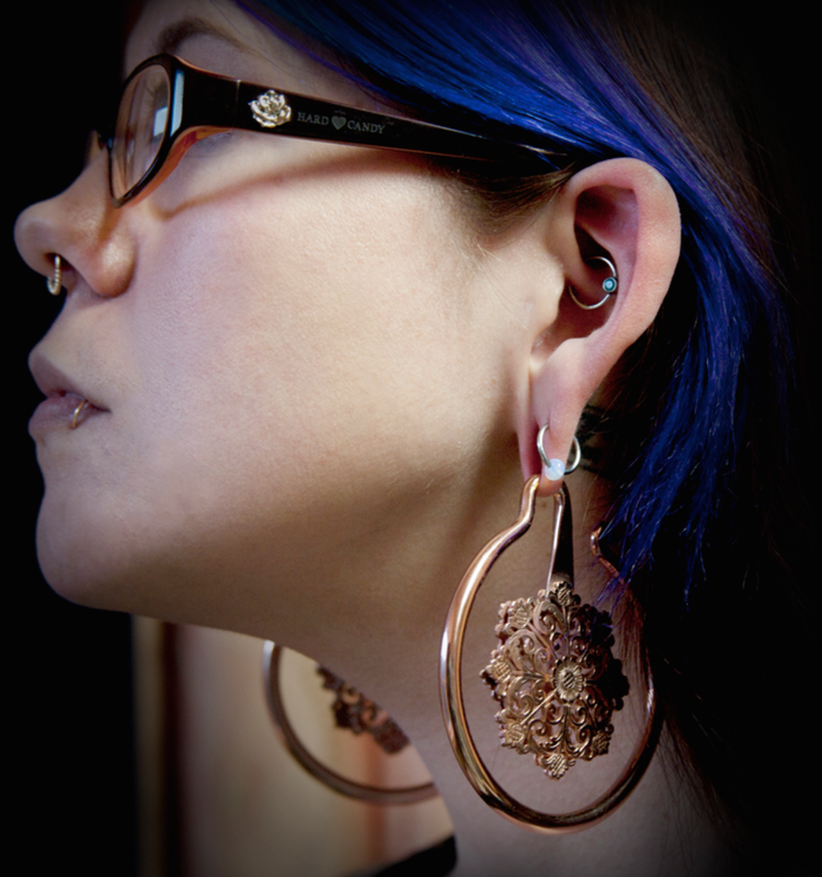 Black Hole Body Piercing client displaying ear and septum piercings